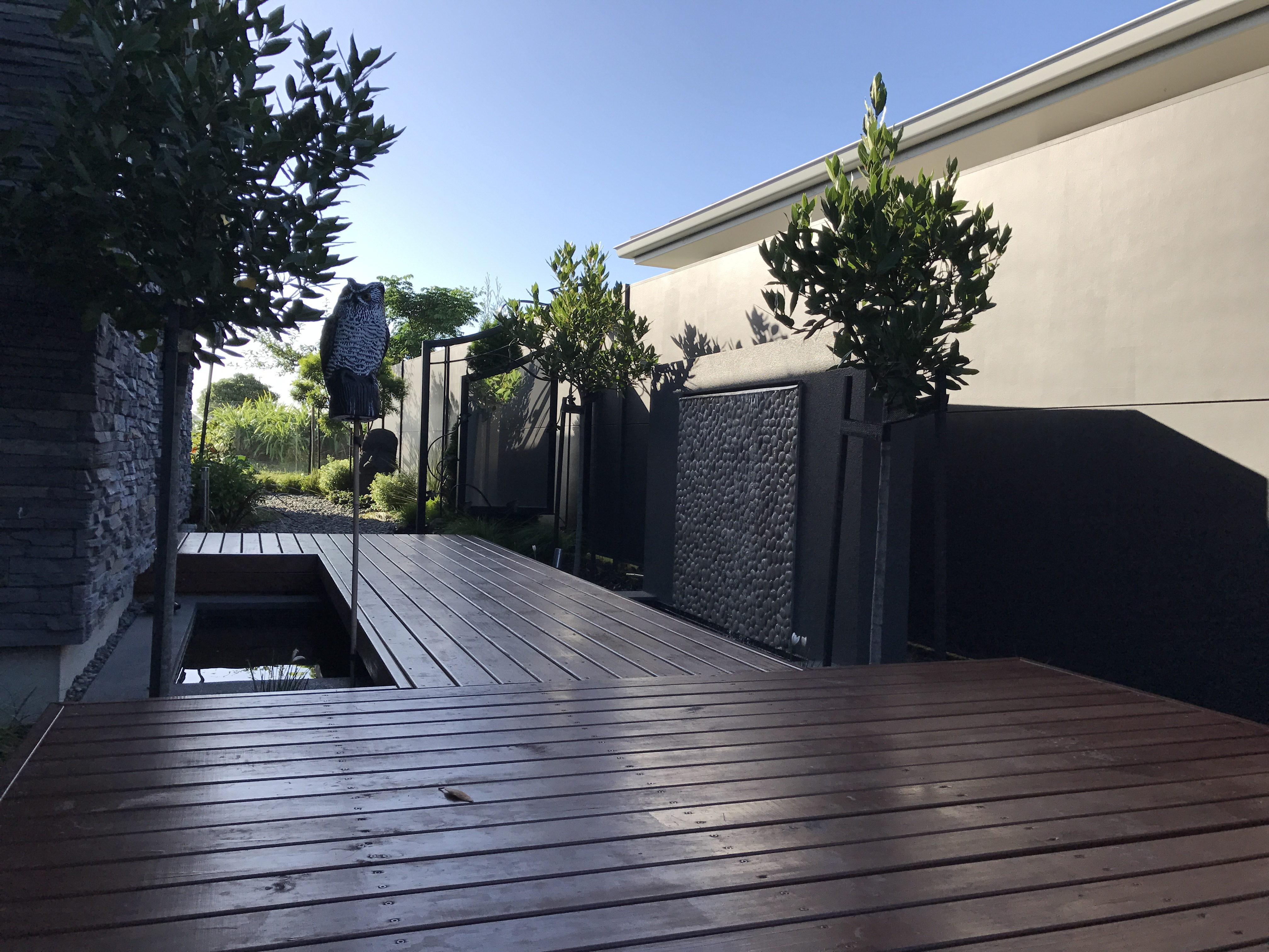 Front entrance way, water feature, decking board walk with formal planting