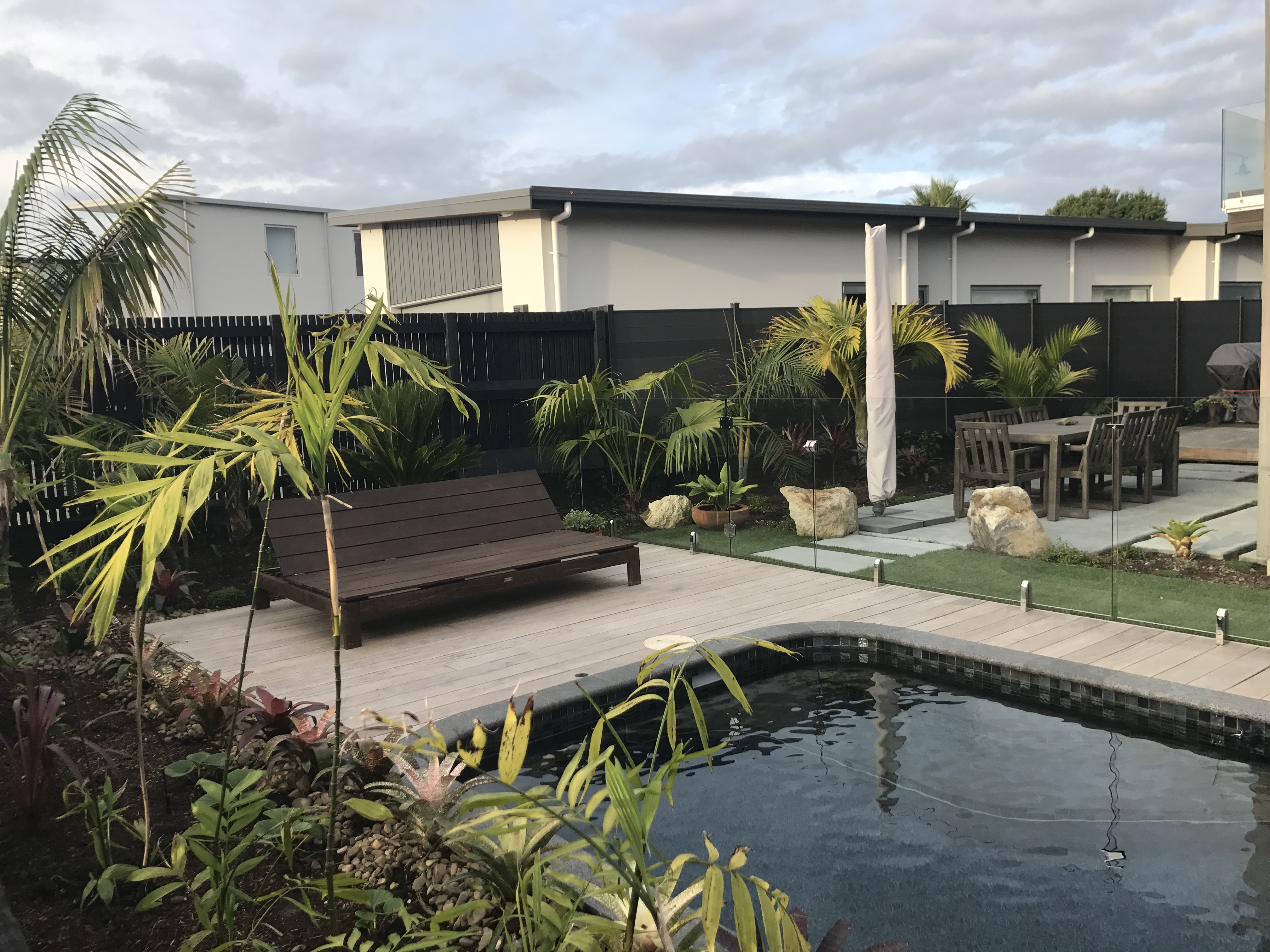 Decking, tropical planting, pool